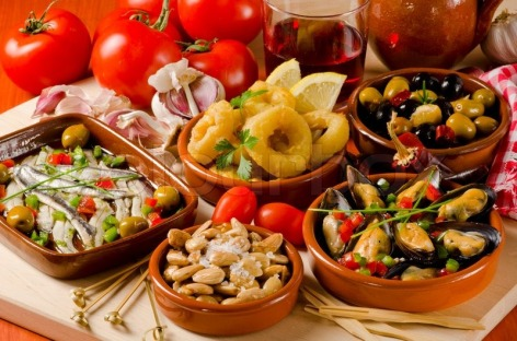 spanish-cuisine-assorted-tapas-on-ceramic-plates